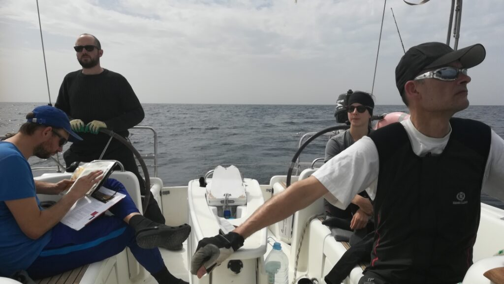 The crew of our sailing boat enjoying the good sail in Cape Verde