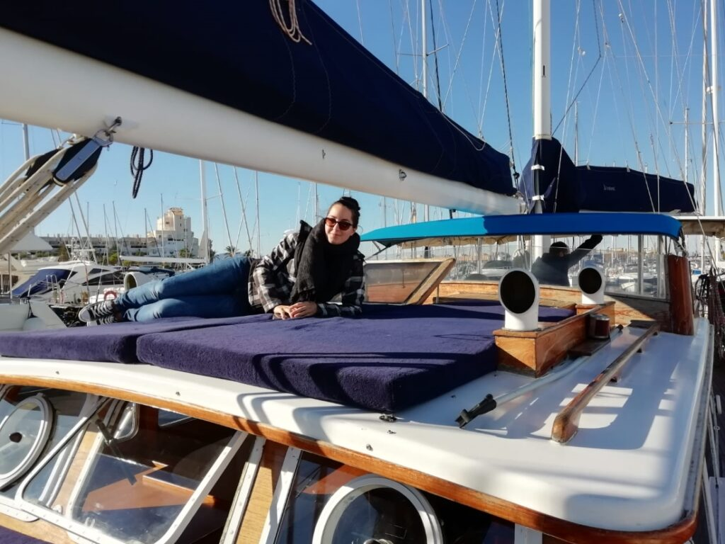 Pati taking a break on deck during sailboat inspection