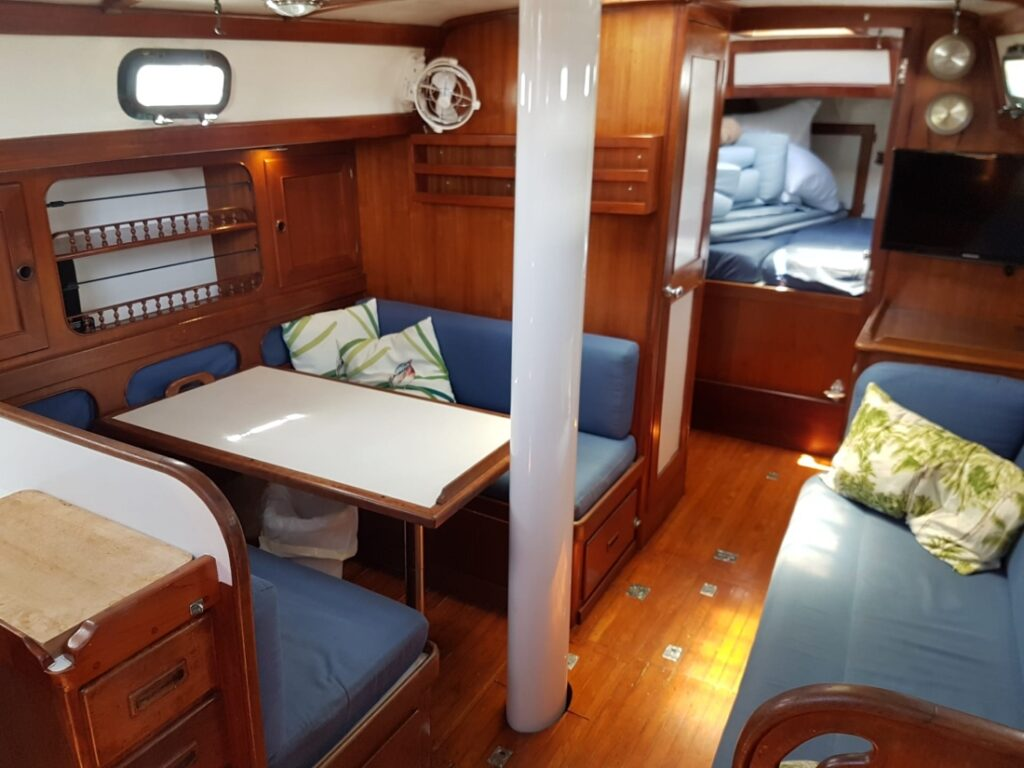 Typical saloon of  a Kelly Peterson 44: eating area on port side and couch on starboard side.