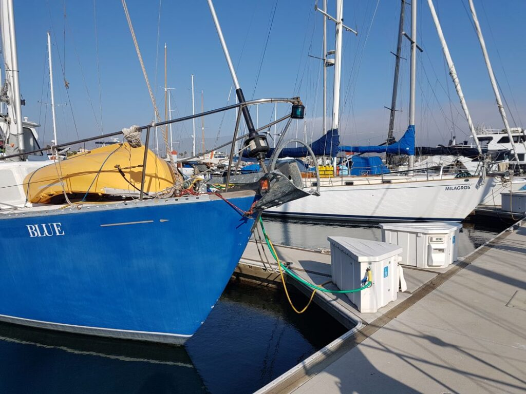 Blue and Milagros sitting next to each other in the marina in Ensenada
