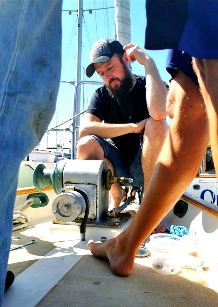 Dave sitting next to the anchor windlass, trying to understand the miracle