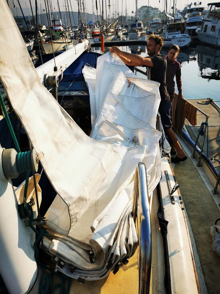 Hoisting the Mainsail of Milagros