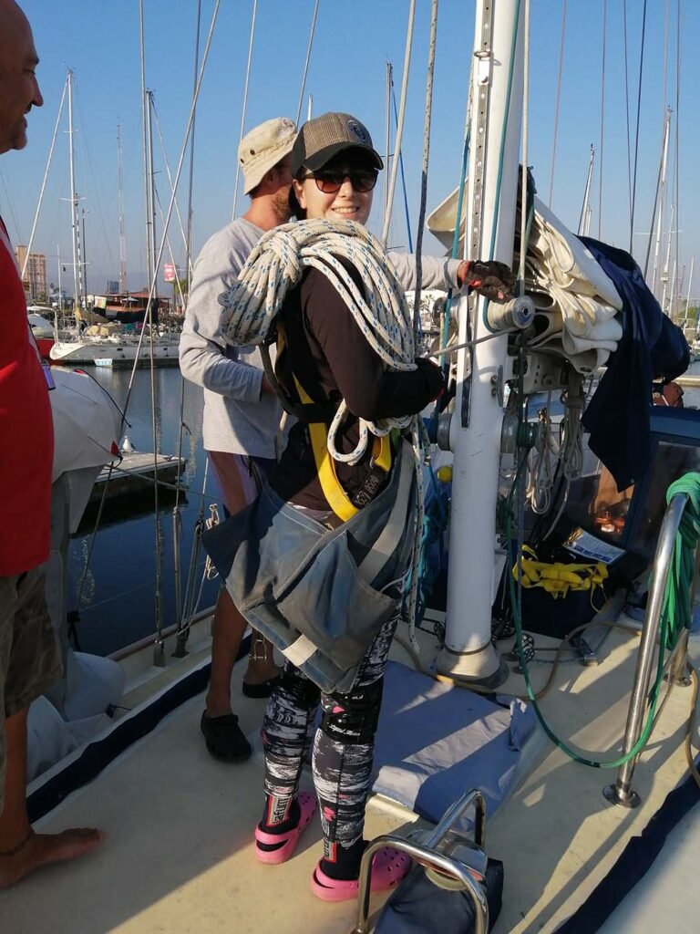 Pati geared up to work on the mast
