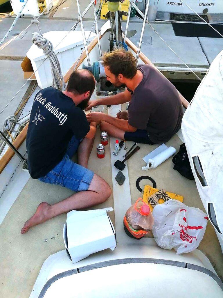 Dave and Iñaki working on the anchor windlass