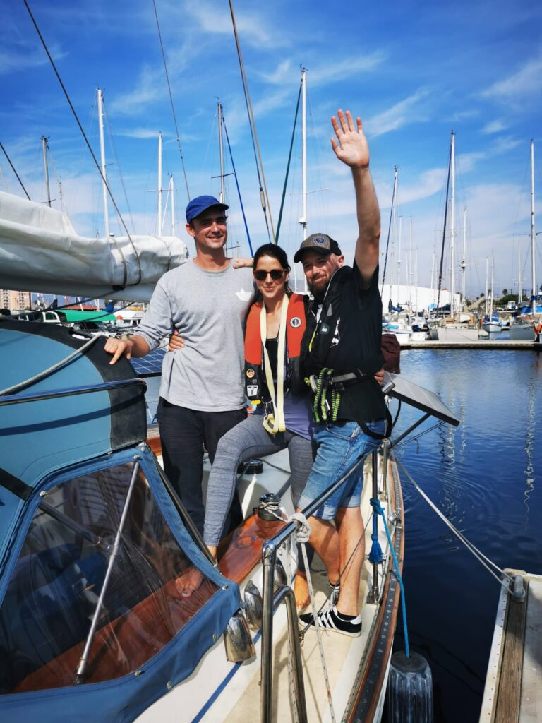 The crew waving good bye when leaving for Magdalena Bay