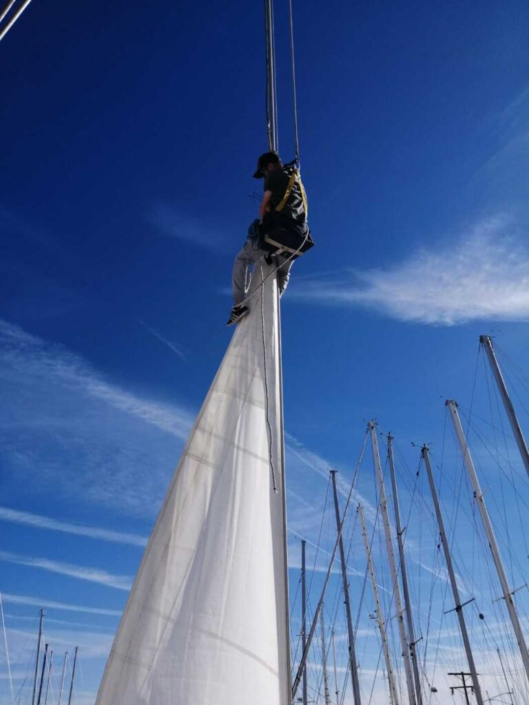 David climbing the forestay and trying to lower the headsail