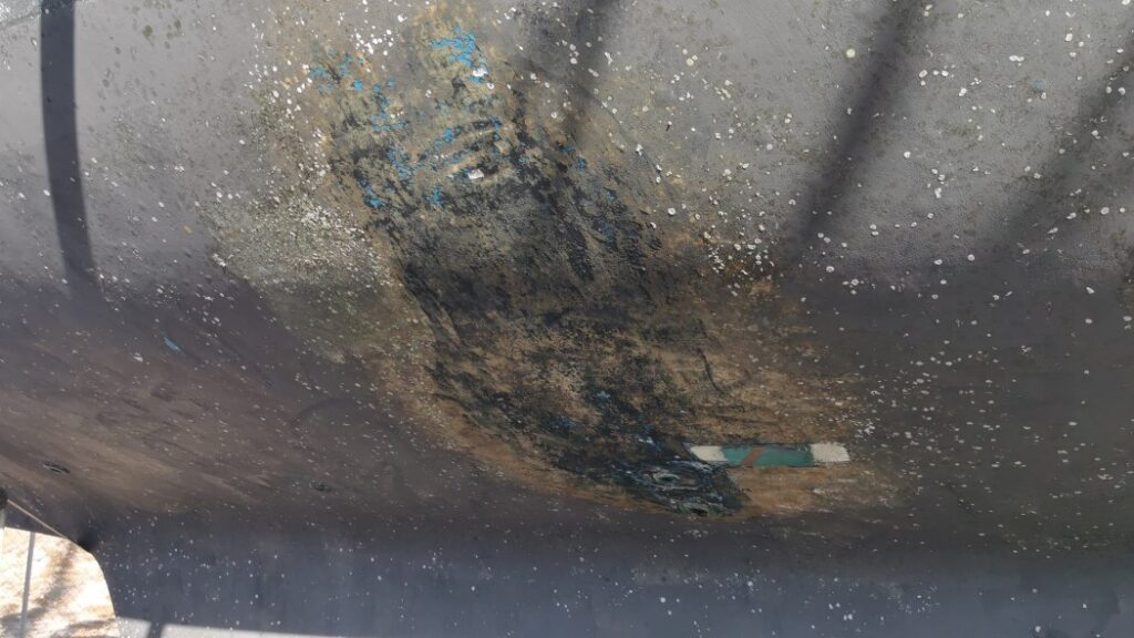 Damaged paint before boat refit