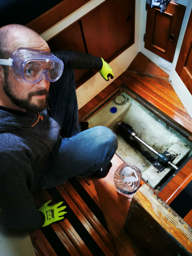 Dave pouring muriatic acid in the screw holes to loosen them