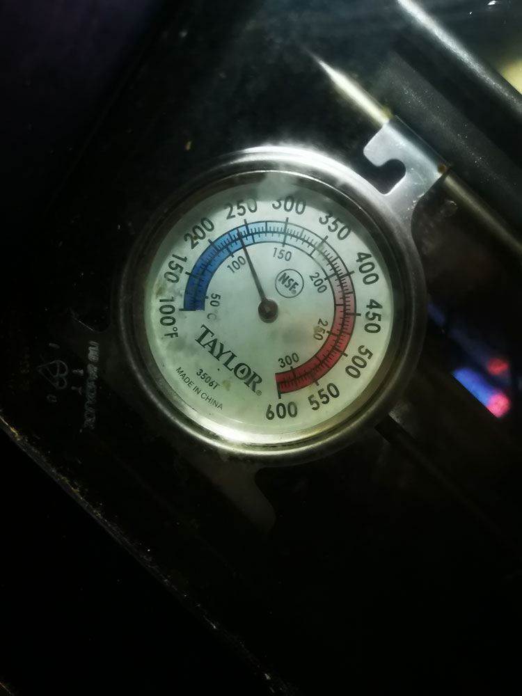 The oven thermometer show the low baking temperature