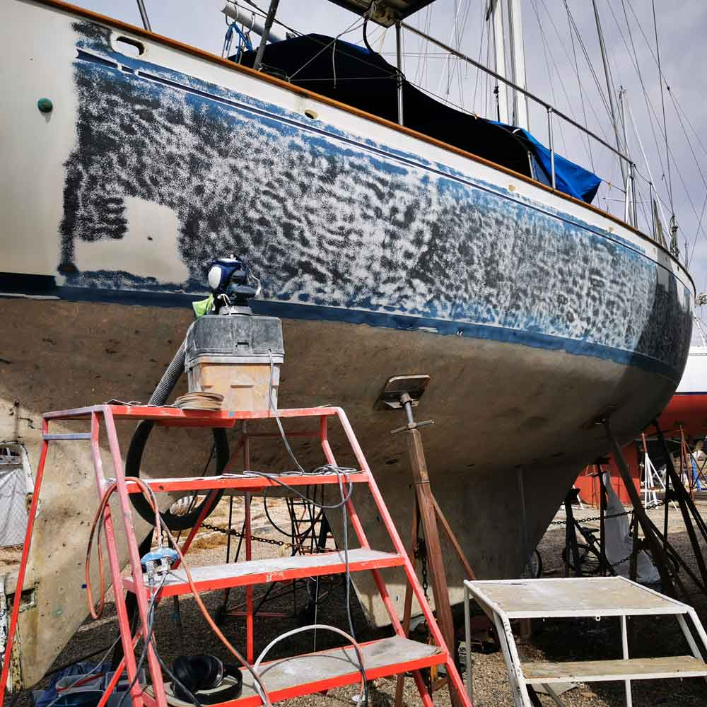Sanding the gelcoat of a sailboat